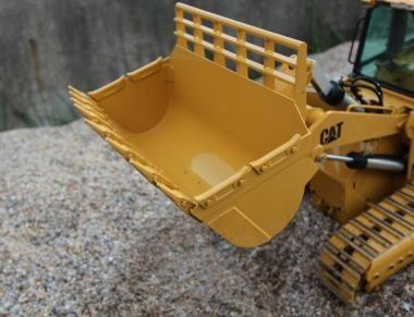 Rock shovel for track loader
